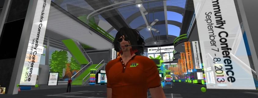 Nebadon Izumi wearing a volunteer tshirt from OSCC13